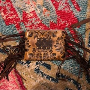 Hand-tooled leather Louis Vuitton wristlet